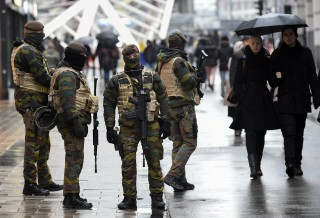 "Soldiers patrol the Rue Neuve pedestrian shopping street in Brussels on November 21, 2015. All metro train stations in Brussels will be closed on November 21, the city's public transport network said after Belgium raised the capital's terror alert to the highest level, warning of an ""imminent threat"". As Europe tightens security a week on from the jihadist attacks in Paris that left 130 people dead, Belgium's OCAM national crisis centre raised its alert level to 4 early on November 21, ""signifying a very serious threat for the Brussels region"". AFP PHOTO / JOHN THYS        (Photo credit should read JOHN THYS/AFP/Getty Images)"